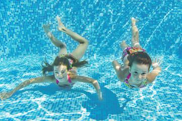 Happy smiling underwater children in swimming pool, kids sport