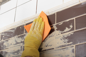 Grouting ceramic tiles