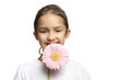 Girl smiling with pink flower