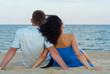 Romantic couple admiring the ocean
