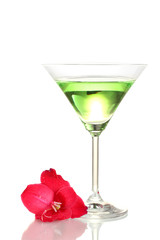 glass with cocktail and gladiolus bud isolated on white