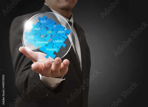 business man shows business puzzles with glass shield
