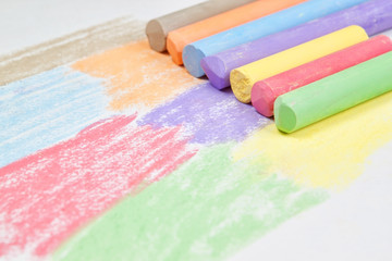 Children drawing with chalk.