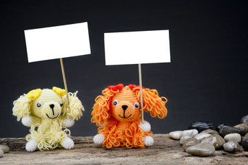 dolls dog holding a placard