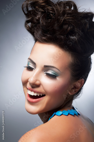 Delight.  Elation. Beautiful young happy woman laughing with joy