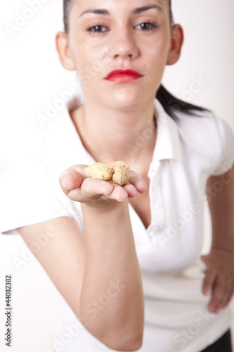 Young girl with peanuts in hands