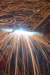 Worker welding metal. Production and construction