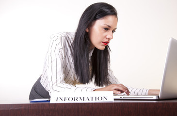 Young attractive female secretary working