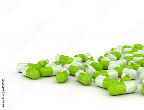 Green pills on white background