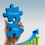 """""""partnership"""" written puzzle pieces in hand"""