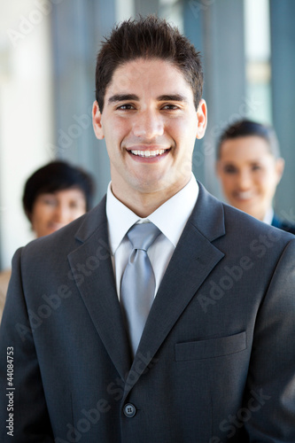 happy and handsome young businessman and co-worker