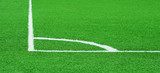 Corner of a football (soccer) field is made from synthetic lawn poster