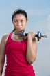Chinese woman exercising with dumbbells