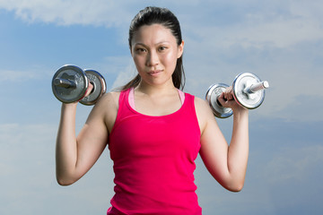 Chinese woman exercising with dumbbells.