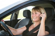 Mature woman driving car and calling