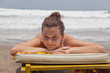 girl lies on a beach plank bed
