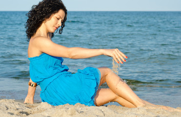 Woman playing with sea sand
