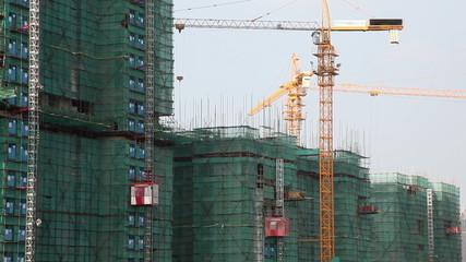 Construction Elevators and tower cranes