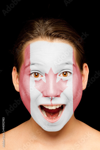 girl with canadian flag on her face