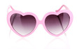 Pink heart-shaped sunglasses isolated on white