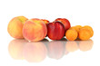 Ripe nectarines, apricots and peaches isolated on white