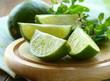 Fresh organic cut  limes on wooden table