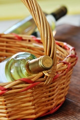 Bottles of fine italian white wine in a basket