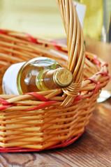Bottle of fine italian white wine in a basket