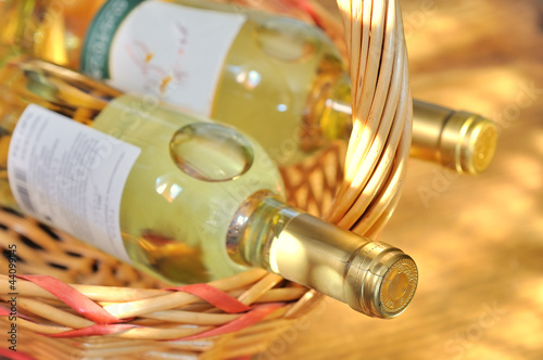 Bottles of fine italian white wine in a basket