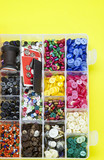 assortment of buttons in box