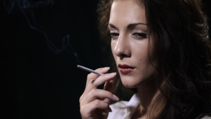 woman smokes cigarette