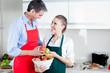 Happy Couple in Kitchen Preparing Food