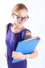 Pretty redhead woman with eyeglasses holding a folder