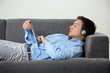 Relaxed Man Listening Music On Digital Tablet