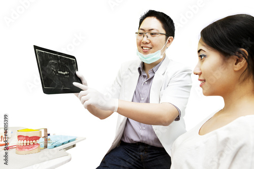Dentist showing x-ray to his patient