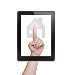 Hand pushing home button of tablet on a touch screen