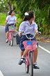Thai Schoolgirl riding a bicycle