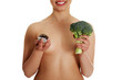 Young naked woman holding vegetable and cake.