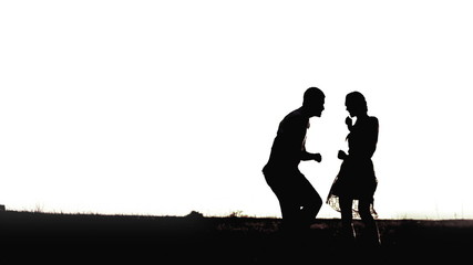 Young black couple silhouettes dancing isolated on white