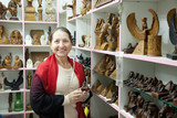 woman  chooses souvenirs in egyptian shop