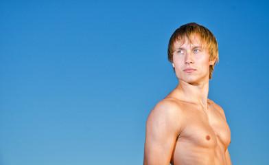 Portrait of handsome man on sky background
