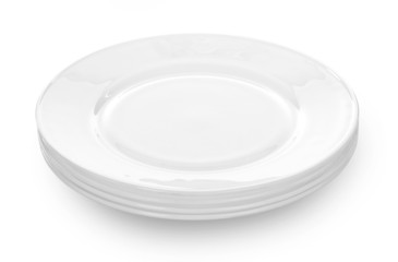 Stack of white plates on white background.