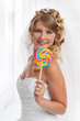 Smiled beauty bride with candy