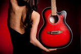 Fototapety Carmen beautiful woman with guitar on dark background