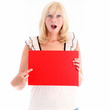 Beautiful blonde woman pointing to a blank red board