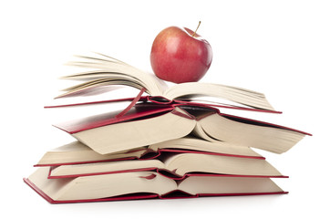 Red apple on the pile of books on white background