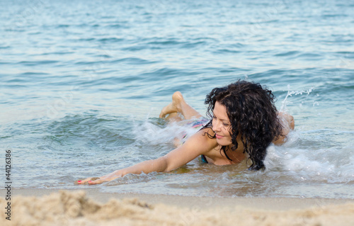 Woman frolicking in the surf
