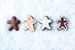 Row of gingerbread men in snow
