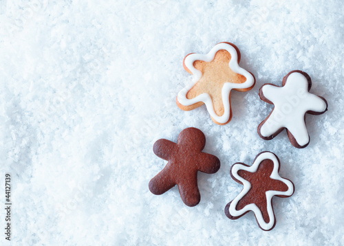 Christmas gingerbread men on snow