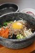 Korean rice with vegetable pork egg in hot bowl